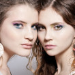 Closeup portrait of two gorgeous women - Stock Photo