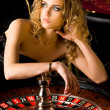 Stock Photo: Sexy young girl in casino