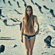 Sexy young topless girl in a deserted place — Stock Photo
