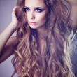 Sexy young woman with beautiful long hair — Stock Photo #11695202