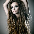 Sexy young woman with beautiful long curly hair — Stock Photo
