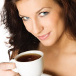 Beautiful young girl with a cup of hot coffee drink — Stock Photo