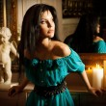 Beautiful sexy young woman near a mirror — Stock Photo