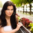 Young woman in a cafe outdoors — Stock Photo #11699724