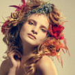 Stylized summer portrait of a young beautiful woman with flowers - Stock Photo