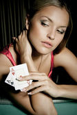 Sexy young girl in casino — Stockfoto