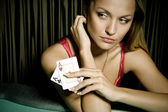 Sexy young girl in casino — Stock Photo
