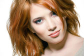 Closeup portrait of a sexy young woman with red hair and natural — Stock Photo