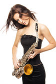 Beautiful young sexy women with saxophone — Stock Photo