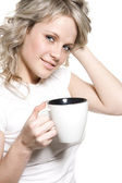 Lovely girl with a cup of hot drink — Stock Photo