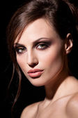 Face of a sexy young brunette woman with perfect skin — Stock Photo