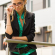 A beautiful young business woman wearing glasses — Stock Photo