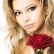Closeup studio portrait of a beautiful sexy young woman with red rose — Stock Photo #11895150