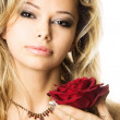 Closeup studio portrait of a beautiful sexy young woman with red rose — Stock Photo #11895156