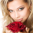 Closeup studio portrait of a beautiful sexy young woman with red rose — Stock Photo #11895161