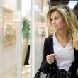 Young blond woman shopping - Stock Photo