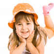 Adorable little girl in orange hat - Stock fotografie