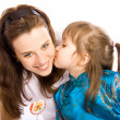 A lovely little girl kissing her mother — Stock Photo