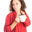 Beautiful young girl with a cup of hot coffee, isolated on white — Stock Photo