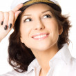 Closeup studio portrait of a sexy young woman in sailor cap - Stock Photo