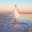 Beautiful young woman in white dress at the lake — Stock Photo #11895701
