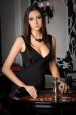 Young sexy girl in casino — Stock fotografie