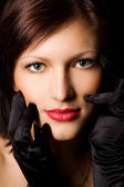 Closeup portrait of a beautiful younf brunette woman — Stock Photo