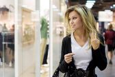 Young blond woman shopping — Stock Photo