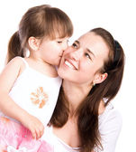 A lovely little girl kissing her mother — Fotografia Stock