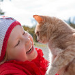 Little girl holding a cat — Stock Photo #11219627