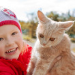 Little girl holding a cat — Stock Photo #11219662
