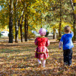Children walking in autumn park — Stock Photo
