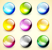 Définir des sphères brillantes de couleur — Vecteur