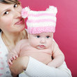 Постер, плакат: Lucky making look younger mother with breast child