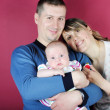 Lucky making look younger family with breast child — Stock Photo #10736407