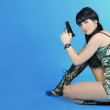 Beautiful girl with weapon — Stock Photo #10828679