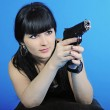 Beautiful girl with weapon — Stock Photo #10828704