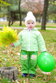 Small beautiful girl in green suit — Stock Photo