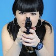 Beautiful girl with weapon — Stock Photo #11861859