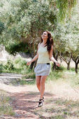 A woman walks in the park — Stock Photo
