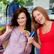 Two women go shopping - Lizenzfreies Foto