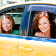 Two women in a taxi — Stock Photo