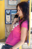Woman in call box — Stock Photo