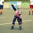 The little boy skates on roller-skaters — Stock Photo