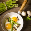 Asparagi with fried egg — Stock Photo #10851432