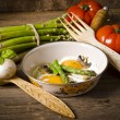 Asparagi with fried egg - Stock Photo