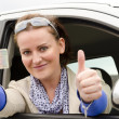 Woman with driving licence - Stock Photo