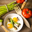 Stock Photo: Asparagi with fried egg