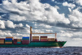 Ship with containers out into the open sea — Stock Photo