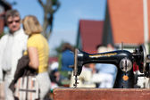 Vintage sewing machine on the streets during the fair — Stock Photo